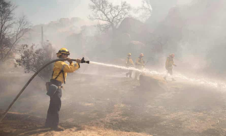 The Los Angeles Fire Department, mops up the outbreak of flames at Foot Hill Park, Simi Valley.