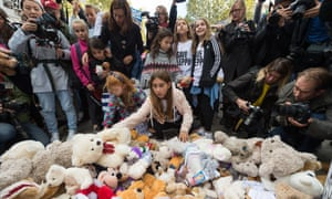 People lay teddy bears at the rally for Aleppo outside Downing Street