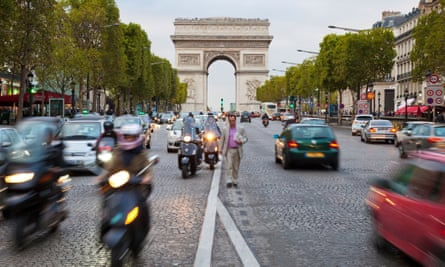 The Avenue des Champs-Elysees in front of the Arc de Triomphe in Paris. The road will be closed to vehicles one Sunday a month to combat pollution.