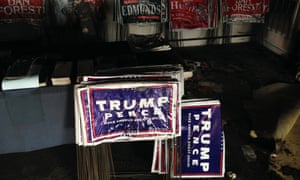 Melted campaign signs are seen at the fire-damaged Orange County Republican Headquarters in Hillsborough, North Carolina.