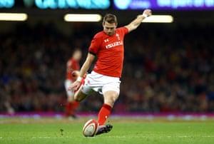 Dan Biggar of Wales kicks and converts a penalty.
