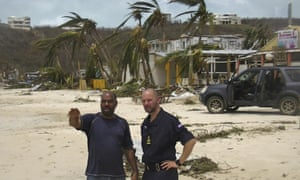 An officer from RFA Mounts Bay (R) talks with a member of the Anguilla disaster relief organisation.