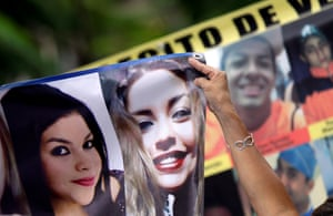 Central America women rally in Cordoba, in the Mexican state of Veracruz, holding pictures of a relatives who disappeared during their journey through Mexico on their way to the US.