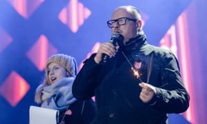 Mayor Adamowicz speaking at the charity event on 13 January before he was stabbed.