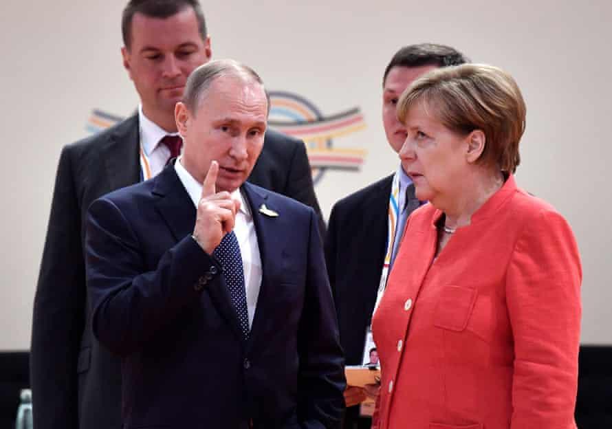 Merkel and Vladimir Putin at a G20 meeting in Hamburg in July 2017