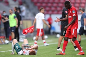Josh Sargent of Bremen lays dejected on the pitch after the game.