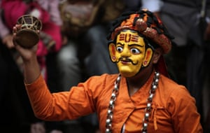 A masked dancer performs as part of a festival celebrating Indra, the god of rain, and the end of monsoon season in Kathmandu, Nepal