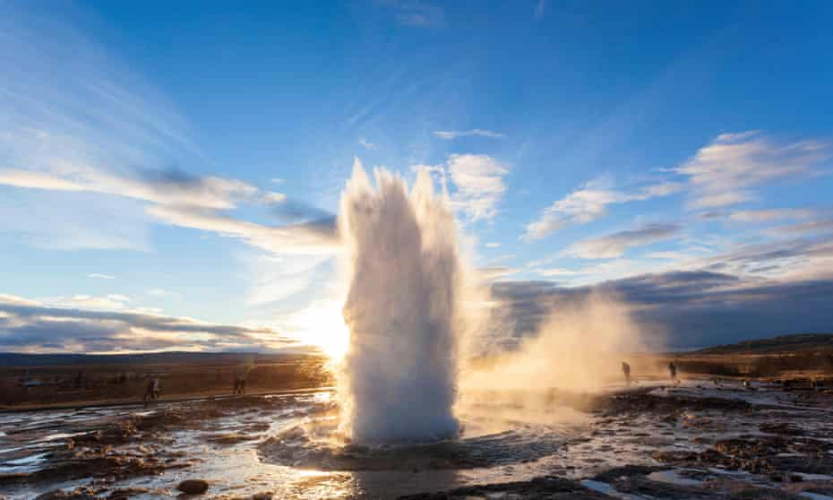 Strokkur Geyser, a shoot of water rising upwards out of the ground. Iceland.