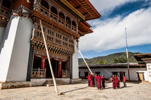Monks erect supports to carry out maintenance work at Gangtey Goempa Monastery, Phobjikha Valley