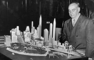 Park Commissioner Robert Moses is shown with the model of the lower end of Manhattan and the bridge with which it is proposed to connect Battery Park