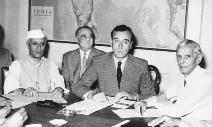 Lord Mountbatten and Indian leaders sign documents to agree upon the partition of India in 1947.