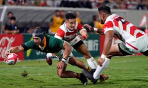 Cheslin Kolbe scores a try for South Africa against Japan.