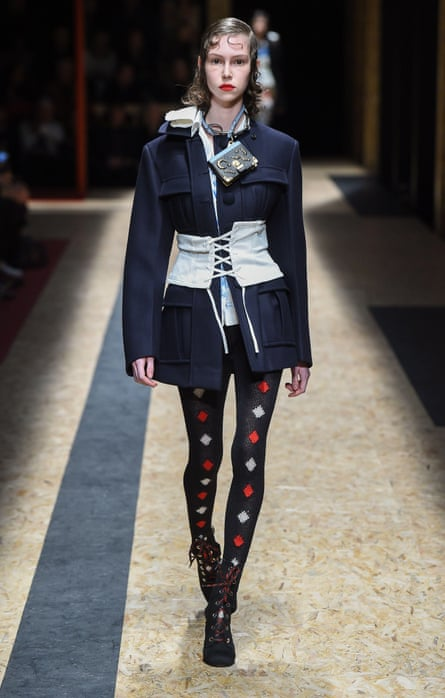 Worn wonky over an overcoat … a corset at the Prada AW16 show, Milan Fashion Week.