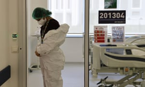 A health official prepares to treat a coronavirus patient in the Covid-19 intensive care unit of Ankara City Hospital in Turkey.