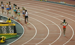Ethiopia's Almaz Ayana, right, stops after winning the gold medal in the Women's 10,000m final as lapped runners continue to race.