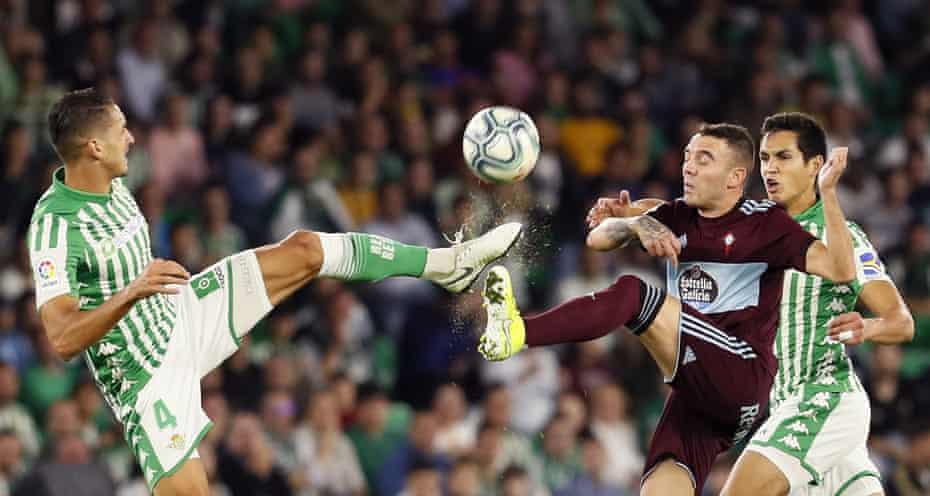 Zou Fedal, left, and Iago Aspas battle for the ball.