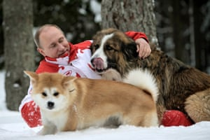 March 2013: Putin plays with his dogs Buffy and Yume at his residence Novo-Ogariovo