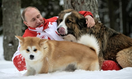 Vladimir Putin plays with his dogs Buffy and Yume at his residence Novo-Ogariovo, outside Moscow.