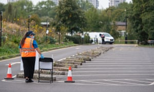 Staff waiting between visitors this morning at a coronavirus testing centre in Southwark, London.