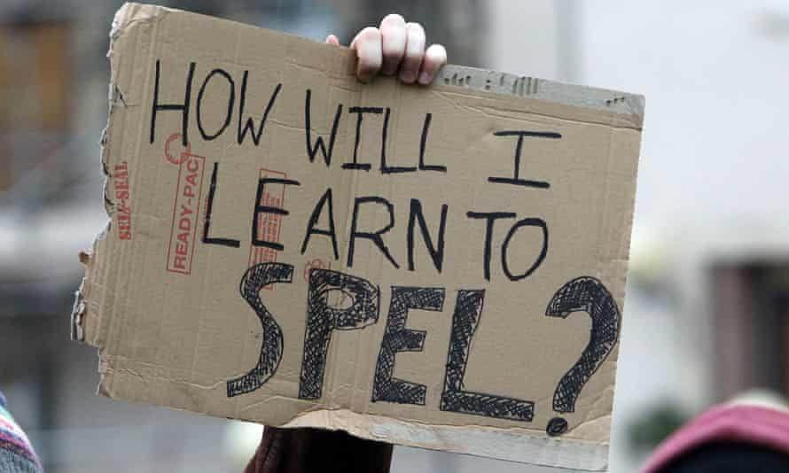 A student protester opposing tuition fee hikes holds a placard at Bristol University.