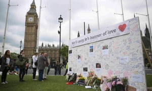 People view tributes for Labour Party MP Jo Cox at Parliament Square in London.