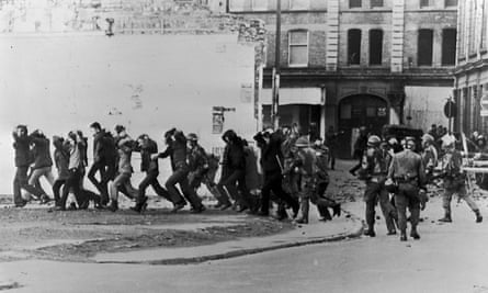 British paratroopers take away civil rights demonstrators on Bloody Sunday.