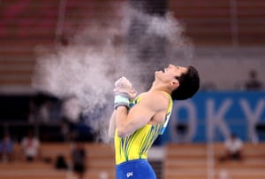 Arthur Mariano of Team Brazil celebrates after competing on horizontal bar.