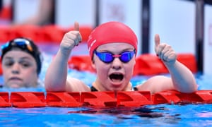 Maisie Summers-Newton celebrates after winning the women's SB6 100m breaststroke final with a new Paralympic record of 1:32.34.
