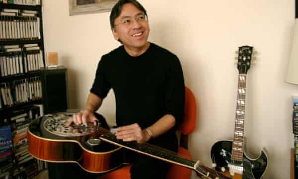 Kazuo Ishiguro at home with his guitars.
