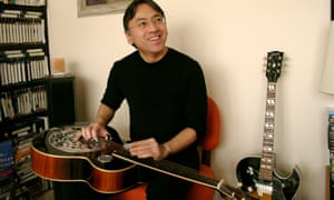 Kazuo Ishiguro at home with his guitars.