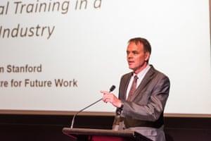 Jim Stanford speaking at a summit in 2018