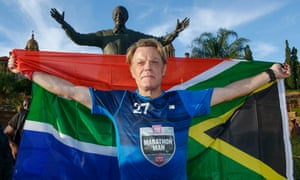 Izzard at the Nelson Mandela statue at the government's Union Buildings in Pretoria, South Africa, after finishing his Sport Relief challenge.