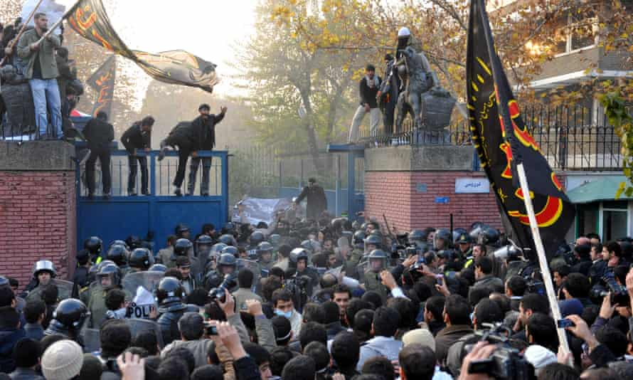 Protesters storm a security gate of the British embassy in Tehran on 29 November 2009.