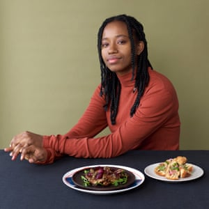 Observer Food MonthlyCaribbean feature - Jamaican chef Danai Moore with her dishes Roasted Spiced Jerusalem Artichokes - Chargrilled Spring Onion Chimichurri - Pea Shoots & Heritage Carrots. (on brown plate) Ackee & 'Saltfish' stuffed fried dumplings - Pickled Red Onions. (on cream plate)
