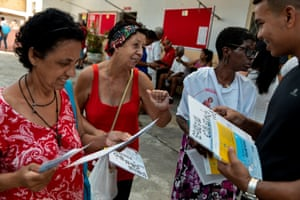 20/01/2019: Renan Perreira distributes pamphlets in front of the church of Saint Sebastian to worshippers visiting the church on the day of the patron saint of Rio de Janeiro