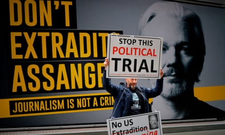 A demonstrator protests outside the Old Bailey in central London on the second day of Julian Assange's extradition hearing.