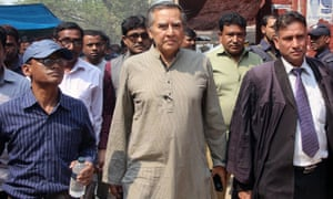 Mahfuz Anam (centre), editor of the Daily Star of Bangladesh, walks from a court in northern Rangpur district after securing bail in March last year over a defamation case filed against him by pro-government activists.