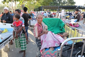 Hospital patients in their beds are moved to an emergency tent outside of Tanjung hospital after the earthquake.