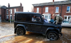 A Land Rover Defender ferries flood victims to safety in Carlisle
