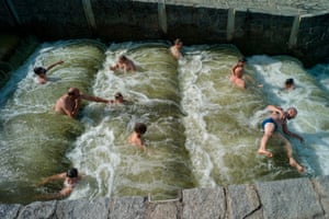 Dobrichovice, Czech Rpublic People cool off in the Berounka river