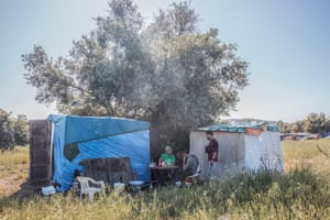 Mawlod Hassan and Daud outside an informal shelter in the migrant worker camp, Cassibile, Sicily.