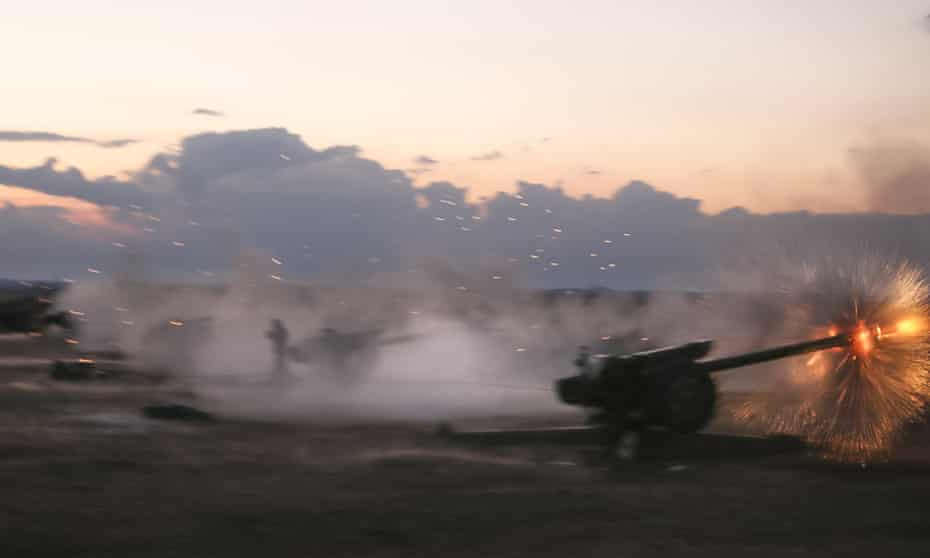 Syrian army howitzers fire