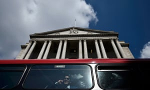 A bus passes the Bank of England in the City of London.