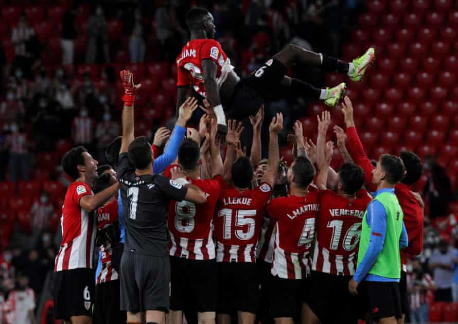 Iñaki Williams is hoisted in the air by his teammates after breaking a La Liga record by playing 203 consecutive matches.