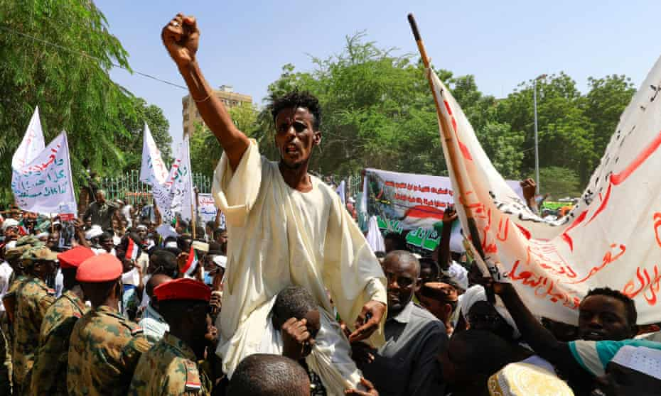 Sudanese protesters take part in a rally demanding the dissolution of the transitional government in favour of military rule