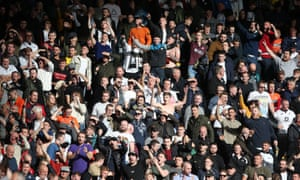 Swansea fans celebrating at full time after a win over Cardiff in October 2019.