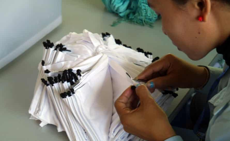 At the Siem Reap factory, which produces lens cloths and spectacle bags for leading brands, workers receive benefits such as help with the cost of education.