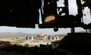 Afghanistan's new parliament building is seen from the ruins of Darul Aman palace in Kabul, Afghanistan.