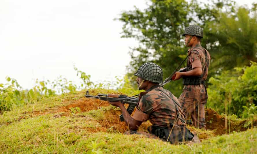 Bangladeshi soldiers at the Bangladesh-Myanmar border. An estimated 2,000 Rohingya have crossed into Bangladesh since Friday.
