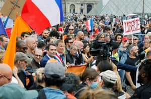 Right wing politicians attend a march in Paris against a planned Covid-19 passport and obligatory vaccinations for health workers